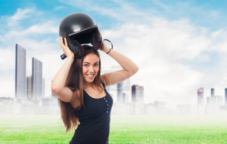 Young woman with a black helmet