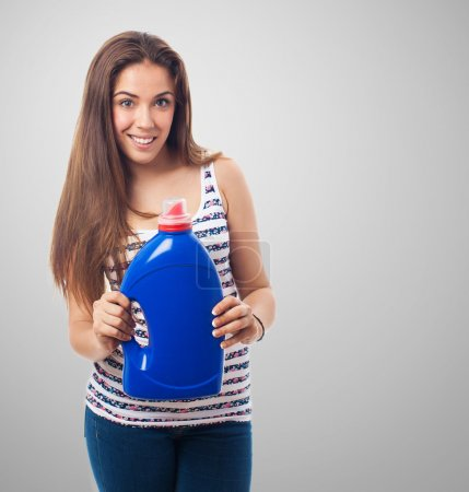 Woman holding a detergent