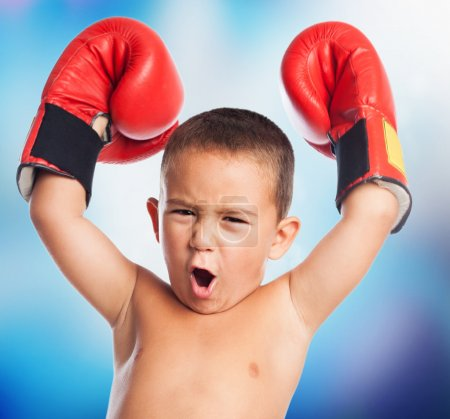 Kid wearing a boxer gloves