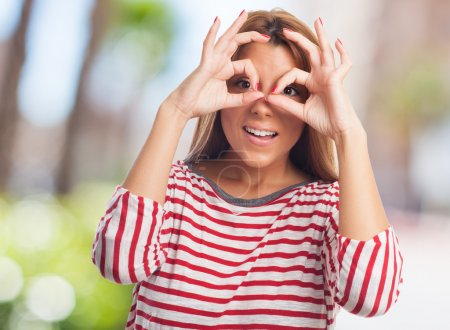Woman doing a glasses gesture