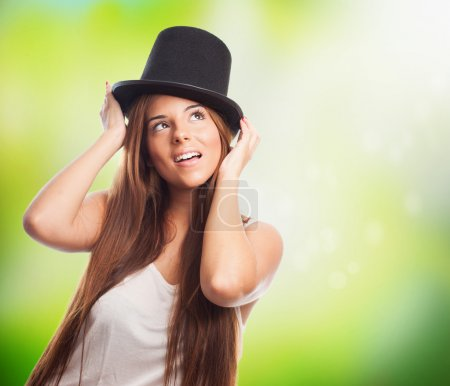 Pretty girl wearing a vintage top-hat
