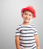 Boy wearing a mason helmet