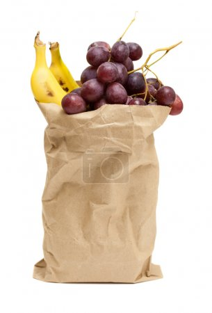 Photo for Fruits in grocery bag on white background - Royalty Free Image