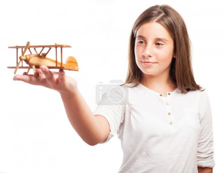 Girl playing with a plane
