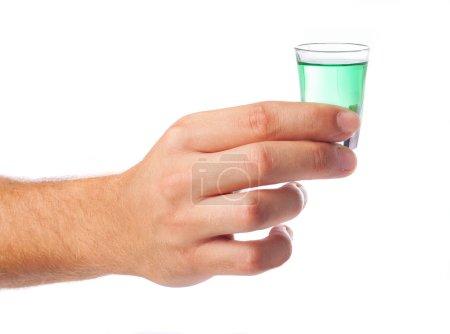 Hand holding one shot