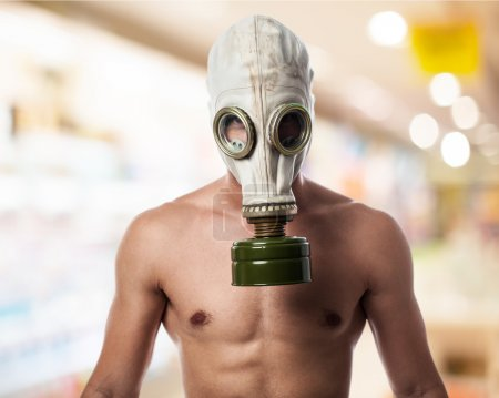 Photo for Young military man with gas mask - Royalty Free Image