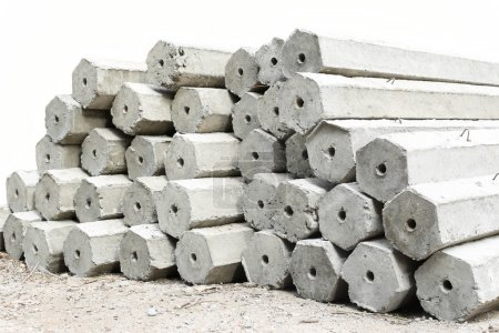 Photo for The pile of hexagon concrete foundation piles isolated in white background - Royalty Free Image