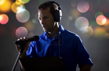Male voice over artist on a microphone