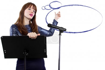 Caucasian girl on a podium with a microphone and b...