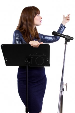 Girl speaking into a microphone and gesturing