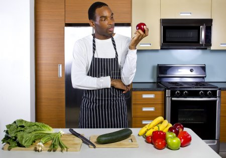 man learning how to cook in a domestic kitchen