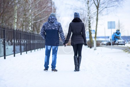 Beautiful adult couple love, park in winter