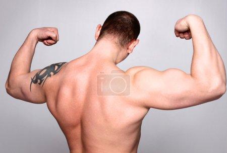 Athletic man standing backwards