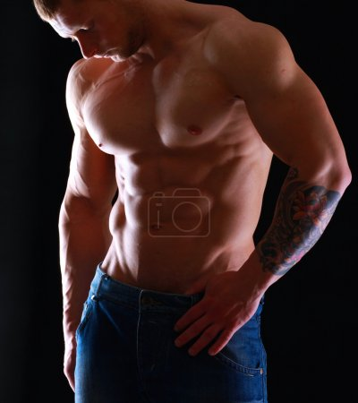 Photo for Healthy muscular young man. Isolated on black background - Royalty Free Image