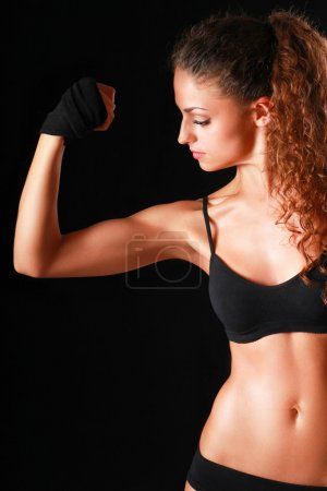 Portrait of young beautiful fitness woman, isolated on black background