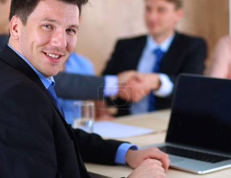 Photo for Business people sitting and discussing at business meeting - Royalty Free Image