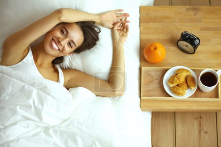 Photo for Young beautiful woman lying in bed. - Royalty Free Image