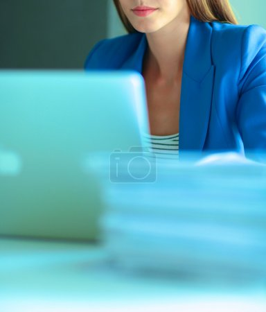 Woman with documents sitting on the desk