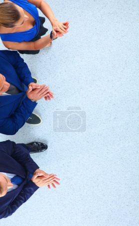 Business people standing together - topview