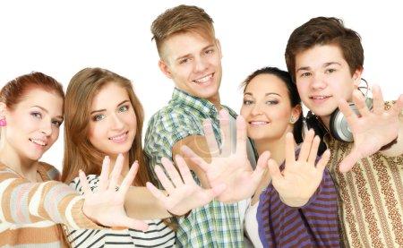 Photo pour Grand groupe d'amis souriant debout ensemble isolé sur fond blanc - image libre de droit