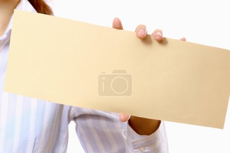 Empty card in female hand on white background.