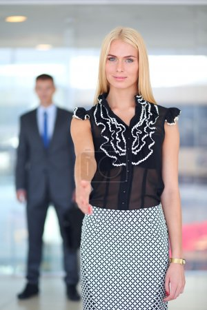 Businesswoman Shaking Hands In Office