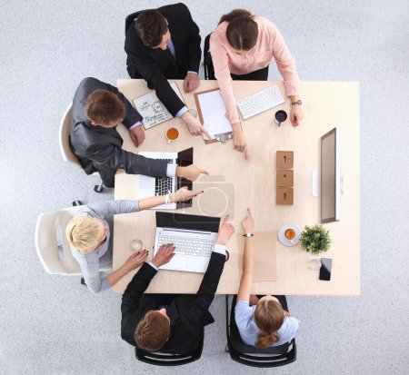 Photo for Business people sitting and discussing at business meeting, in office - Royalty Free Image