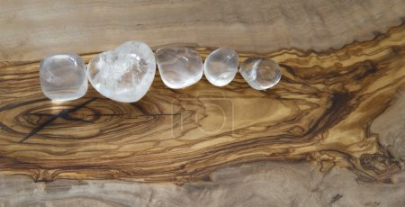 Clear crystals on olive wood background