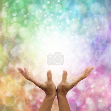 Rainbow healing energy on bokeh background