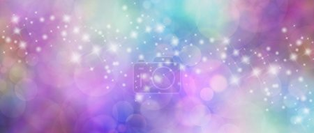 Foto de Wide multicolored bokeh background with a row of different sized sparkles meandering across from left to right - Imagen libre de derechos
