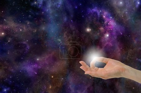 Photo for Gyan Mudra Hand Position creating the Spark of Life on a deep space background with planets, stars, suns, clouds and plenty of copy space - Royalty Free Image
