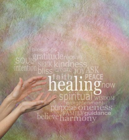 Photo pour Pair of female hands reaching out to the word 'healing' surrounded by a word cloud of healing related words on a rustic stone effect pastel colored background - image libre de droit