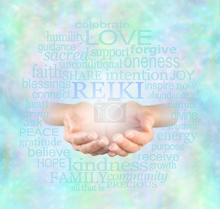 Female hands cupped with the word 'Reiki' floating...