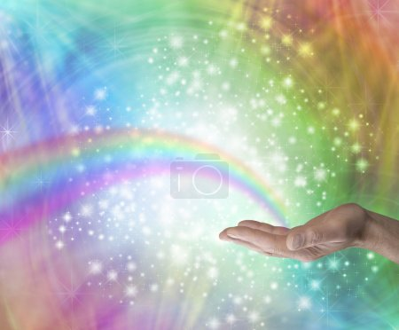 Photo pour Male hand palm up with a rainbow appearing to end in his palm on a rainbow colored background with glittering sparkles and swirling energy - image libre de droit