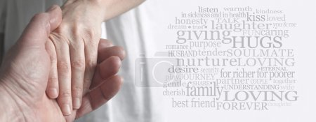 Photo for Wide soft focus cropped image of a man holding a woman's hand tenderly with a love and marriage related word cloud on right hand side - Royalty Free Image