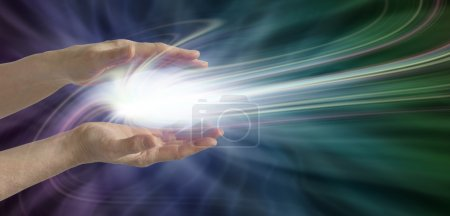 Photo for Parallel female hands with a swirling light burst between on a dark blue, purple and green energy field background - Royalty Free Image