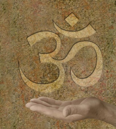 Om symbol engraved on stone effect background with...