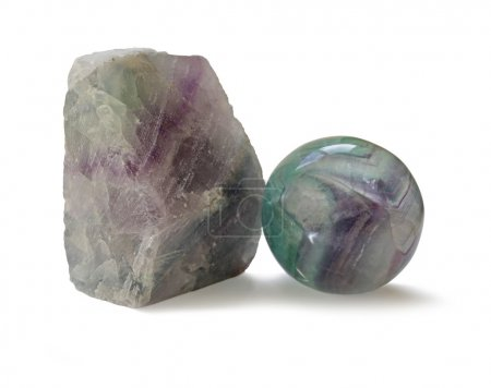 Polished and rough natural specimens of Fluorite banded crystal