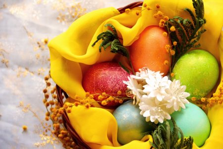 Photo for Easter eggs in basket, painted in different colors with pearly shimmer. Shallow depth of field - Royalty Free Image