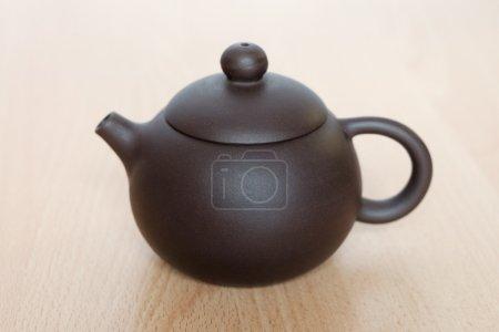 Brown ceramic teapot