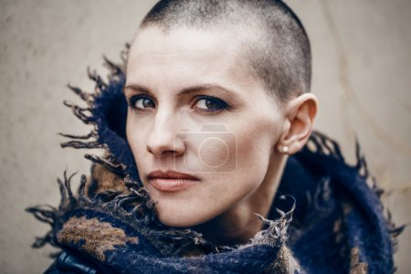 Photo for Closeup portrait of sad beautiful Caucasian white young bald girl woman with shaved hair head in leather jacket and scarf shawl, spiritual mood state of mind - Royalty Free Image