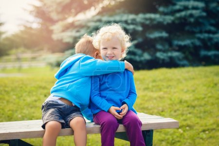 Portrait of caucasian boy  and girl friends in blue hoodies