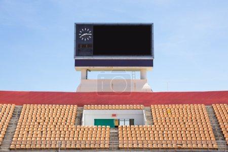 Scoreboard orange seat in stadium