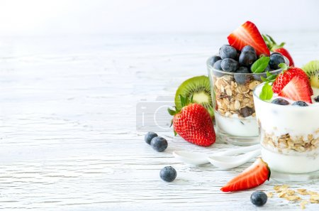 Photo for Granola with berries and fruits copy space background - Royalty Free Image