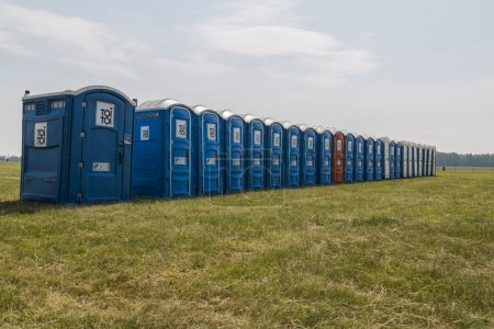 Photo for Bio mobile toilets on grass - Royalty Free Image