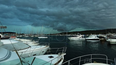 The storm over the harbor with yachts