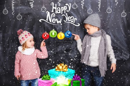 Boy and girl celebrating New Year