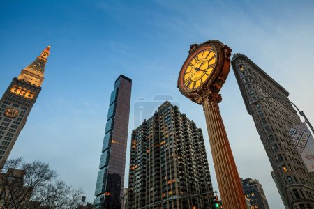 Photo for NEW YORK CITY, NY - AUG 3: Landmark Fifth Avenue cast iron sidewalk clock in Manhattan on Aug 2, 2013. This historic clock in the Flatiron District dates back to 1909. - Royalty Free Image