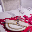 Luxurious dinner in red and white with name tag in...