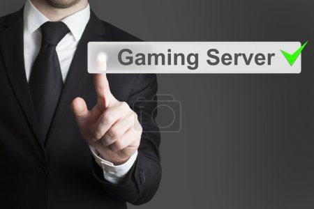 businessman pushing button gaming server checked